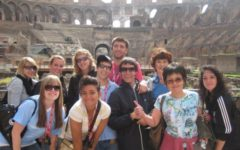 Me with some friends and some strangers at the Coliseum in Rome.